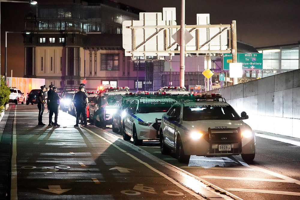 """EXCLUSIVE: **PREMIUM RATES APPLY** Mexican drug lord Joaquín """"ElChapo"""" Guzman is transported from downtown Manhattan via NYPD chopper, final destination: Supermax Prison near Florence, Colorado. The 62 year-old Sinaloa cartel boss is carted away at 3:20am in shackles en route to La Guardia airport. He has been sentenced to life plus 30 years. **NO NEW YORK DAILY NEWS, NO NEW YORK TIMES, NO NEWSDAY**. 19 Jul 2019 Pictured: NYPD escort detail. Photo credit: Christopher Sadowski / MEGA TheMegaAgency.com +1 888 505 6342"""