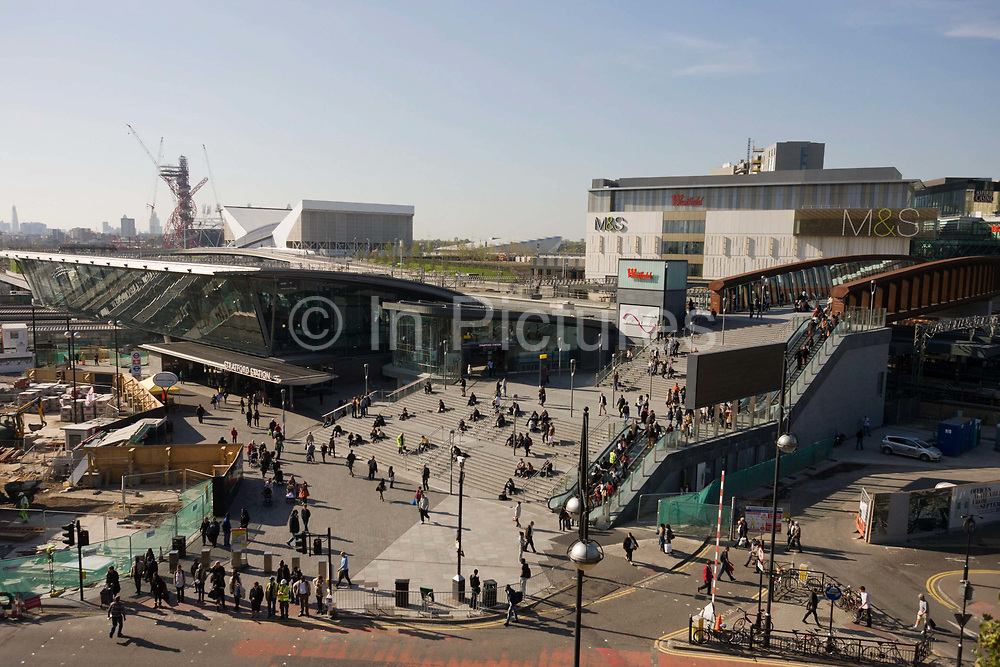 An aerial landscape of Westfield City shopping centre (right) and Stratford rail station hub (L), home and arrival point of the 2012 Olympics. Situated on the fringe of the 2012 Olympic park, Westfield is Europe's largest urban shopping centre. The £1.45bn complex houses more than 300 shops, 70 restaurants, a 14-screen cinema, three hotels, a bowling alley and the UK's largest casino. The station is served by the National Rail services National Express East Anglia, London Overground and c2c, by London Underground's Central and Jubilee lines, and by the Docklands Light Railway (DLR). Stratford is in London Travelcard Zone 3, and Network Rail owns the station.