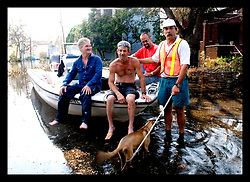 5th Sept, 2005. Hurricane Katrina aftermath. New Orleans. Animal rescue boat. Local man Jimmy Delery (rt) and his merry band of locals assist in the search and rescue animals from the devastating floods in Uptown New Orleans.