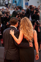 Johnny Depp and Amber Heard with photographers at the gala screening for the film Black Mass at the 72nd Venice Film Festival, Friday September 4th 2015, Venice Lido, Italy.