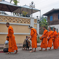 The monks walk in a line, the oldest first.