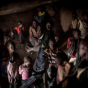 In the village of Buram, the women and children hide in a mountain cave while the bomber is flying above their village. <br /> The bombers are sent by the Sudanese government across the region on a daily basis. They bomb randomly civil and military areas. April 2013