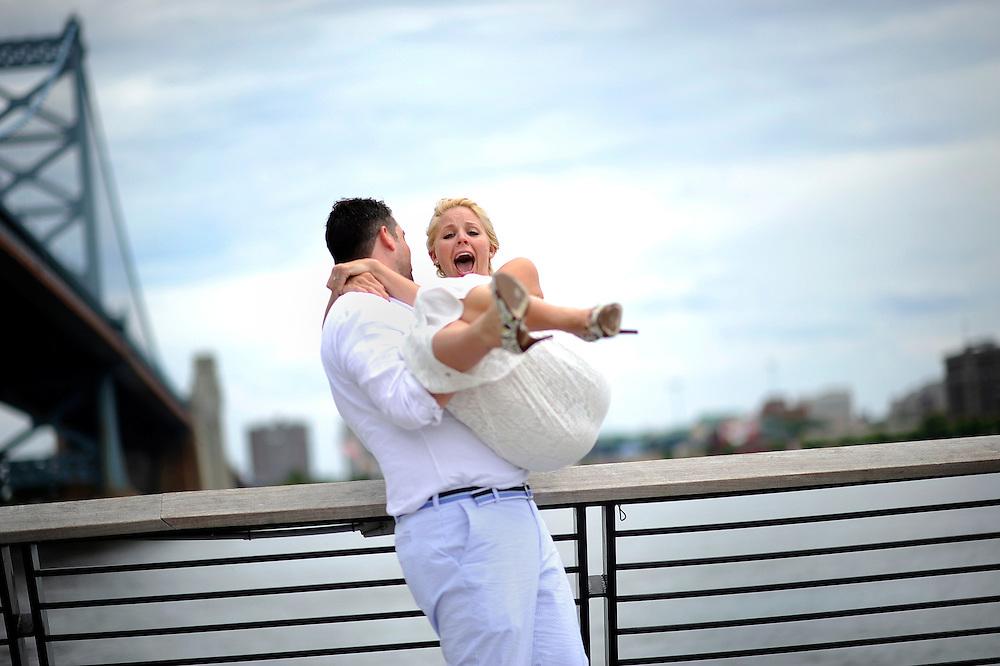 A wedding at Race Street Pier underneath the Benjamin Franklin Bridge in Philadelphia, Pennsylvania.