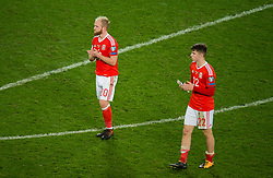 CARDIFF, WALES - Monday, October 9, 2017: Wales' Jonathan Williams and Ben Woodburn react at the final whistle during the 2018 FIFA World Cup Qualifying Group D match between Wales and Republic of Ireland at the Cardiff City Stadium. (Pic by Peter Powell/Propaganda)