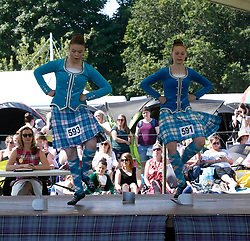 Inveraray Highland Games held in the grounds of Inveraray Castle feature many competitions including piping, highland dancing, field events as well as the usual heavy events.Highland dancers Iona-Maree Scott (L) and Catriona Gammon (R) compete in the dancing event..... (c) Stephen Lawson | Edinburgh Elite media