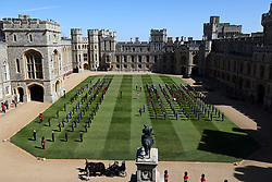 Fell ponies Balmoral Nevis and Notlaw Storm pull the driving carriage of the Duke Of Edinburgh through the quadrangle ahead of the funeral of the Duke of Edinburgh in Windsor Castle, Berkshire. Picture date: Saturday April 17, 2021.