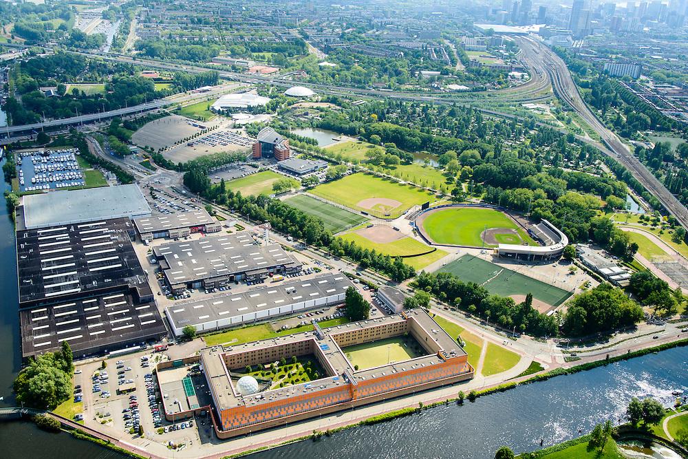 Nederland, Zuid-Holland, Rotterdam, Overschie, 10-06-2015; Penitentiaire Inrichting De Schie (Gevangenis Overschie) in de voorgrond. Diergaarde Blijdorp in de achtergrond.<br /> Rotterdam prison, De Schie.<br /> luchtfoto (toeslag op standard tarieven);<br /> aerial photo (additional fee required);<br /> copyright foto/photo Siebe Swart