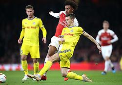 BATE Borisov's Aleksei Rios (right) and Arsenal's Alex Iwobi battle for the ball