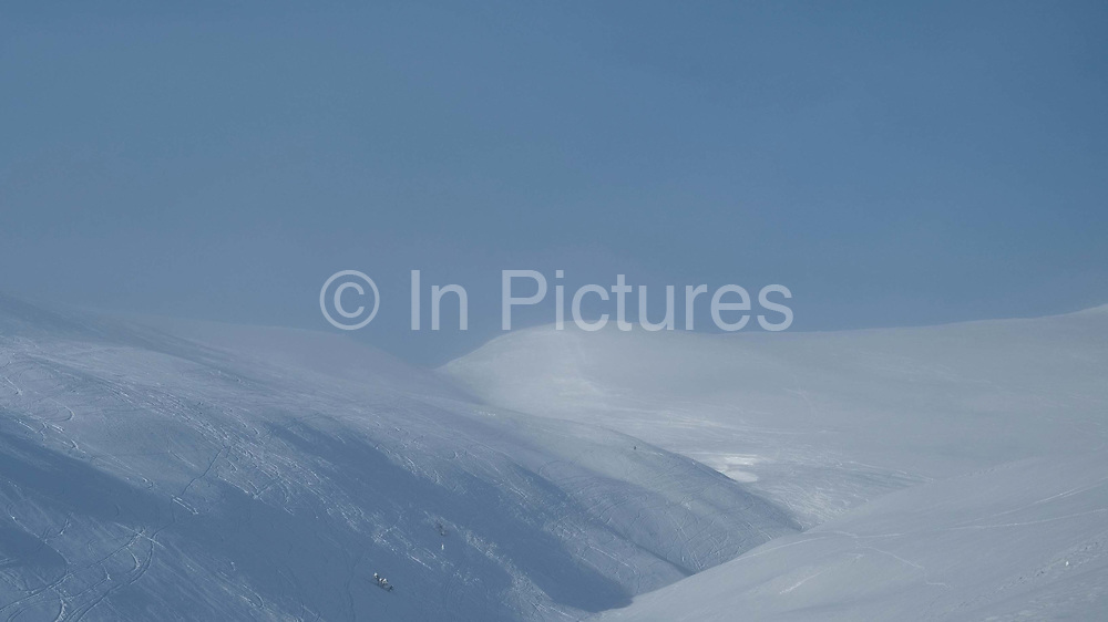 View of the snowy Winter landscape of the forest and fells on 20th February 2020 in Pallas-Yllastunturi National Park, Finnish Lapland. Established in 2005, Pallas-Yllastunturi National Park is the third largest national park in Finland and is located in the Lapland region. The natural features and landscape of the fells have always enchanted hikers and the area offers magnificent fells and seemingly endless woodlands. Reindeer and reindeer husbandry play an important role in the National Park, with the area used for grazing and breeding.