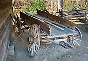 Old wooden wagon with iron tred, at Cable Mill Historic Area, Cades Cove, Tennessee. Cades Cove, once home to numerous settlers, is an isolated valley located in Great Smoky Mountains National Park, USA. Today Cades Cove is the most popular destination for visitors to the park, attracting over two million visitors a year, due to its well preserved homesteads, scenic mountain views, and abundant display of wildlife.