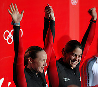 Photo: Catrine Gapper.<br />Winter Olympics, Turin 2006. Womens Bobsleigh. 21/02/2006. <br />Shauna Rohbock and Valerie Flemin of USA celebrate their silver medal.
