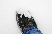 Walker's boot covered in snow, London, England, United Kingdom