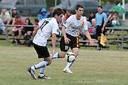 Jeff Campbell (19) and Mark Jones of Waikato. NZFC Championship Soccer - Waikato v Canterbury, Centennial Park, Ngaruawahia. Sunday, 24 January 2010. Photo: Geoffrey Dickinson/PHOTOSPORT