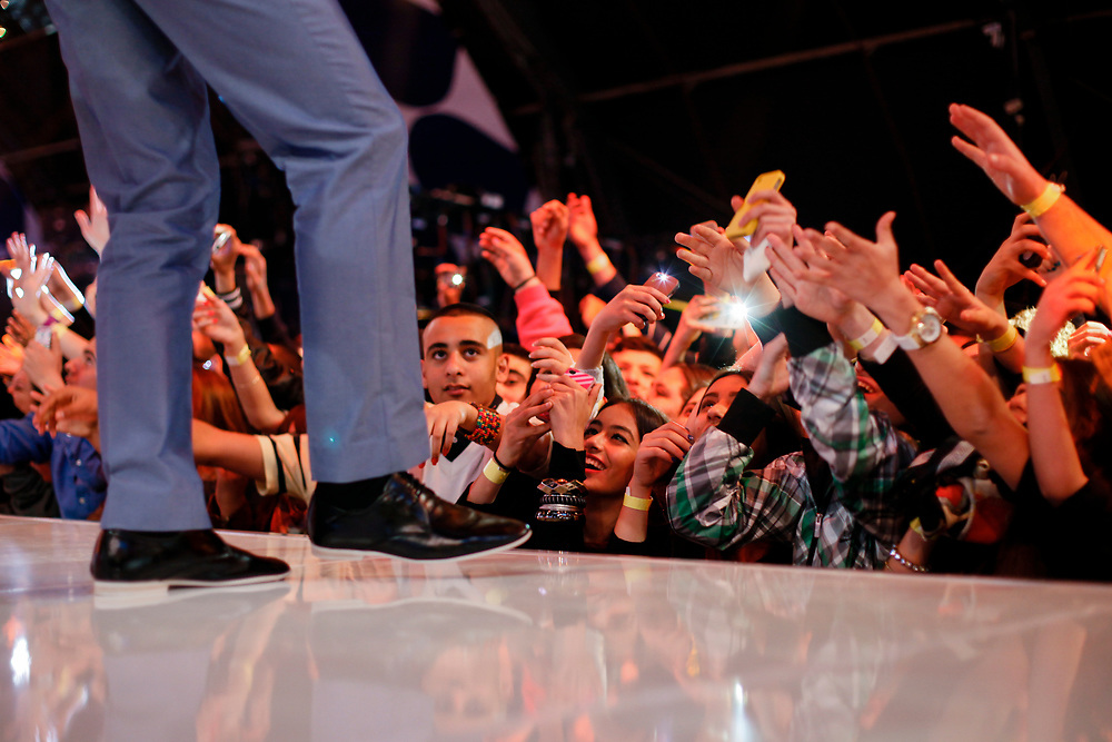 Fans react as a participant of the Israeli version of Big Brother reality-television show greets them, during the Season 4 Finale of the show, at the Neve Ilan studios, outside Jerusalem, Israel, on April 2, 2012.