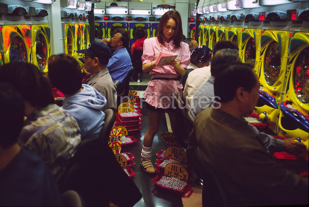 A waitress takes drinks orders in a Pachinko gaming parlour in the Shinkjuko district of Tokyo, Japan