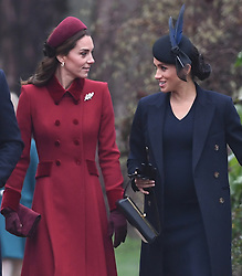 The Duchess of Cambridge and the Duchess of Sussex arriving to attend the Christmas Day morning church service at St Mary Magdalene Church in Sandringham, Norfolk.