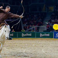 Lajos Kassai follower of the traditional Hungarian horse mounted archery performs his Guinness World Record attempt during the OTP Bank Budapest Grand Prix Horse World Cup in Budapest, Hungary on December 04, 2011. ATTILA VOLGYI