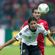 Turkey's Hamit ALTINTOP (R) and Germany's Sami KHEDIRA (L) during their UEFA EURO 2012 Qualifying round Group A matchday 19 soccer match Turkey betwen Germany at TT Arena in Istanbul October 7, 2011. Photo by TURKPIX