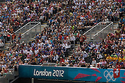 Crowds of sports supporters seem en mass during the canoe slalom heats at the Lee Valley White Water Centre, north east London, on day 3 of the London 2012 Olympic Games.