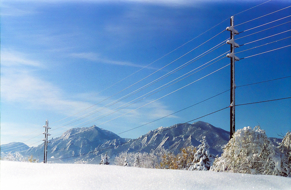 Power lines and the Flatirons in winter, Boulder, Colorado.