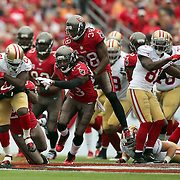 San Francisco 49ers running back Frank Gore (21) runs during an NFL football game between the San Francisco 49ers  and the Tampa Bay Buccaneers on Sunday, December 15, 2013 at Raymond James Stadium in Tampa, Florida.. (Photo/Alex Menendez)