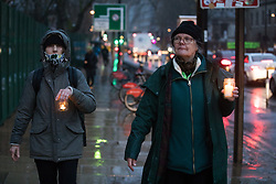 Dorothea Hackman (r) of Camden Civic Society joins environmental activists from HS2 Rebellion at a candlelit vigil for the trees lost, or about to felled, for the HS2 high-speed rail project in Euston Square Gardens on 6 February 2021 in London, United Kingdom. The vigil took place alongside the site of a tunnel in Euston Square Gardens from which bailiffs contracted to HS2 Ltd have been trying to evict nine activists seeking to protect the trees for the past eleven days and also marked the first anniversary of the death of environmental activist Iggy Fox.
