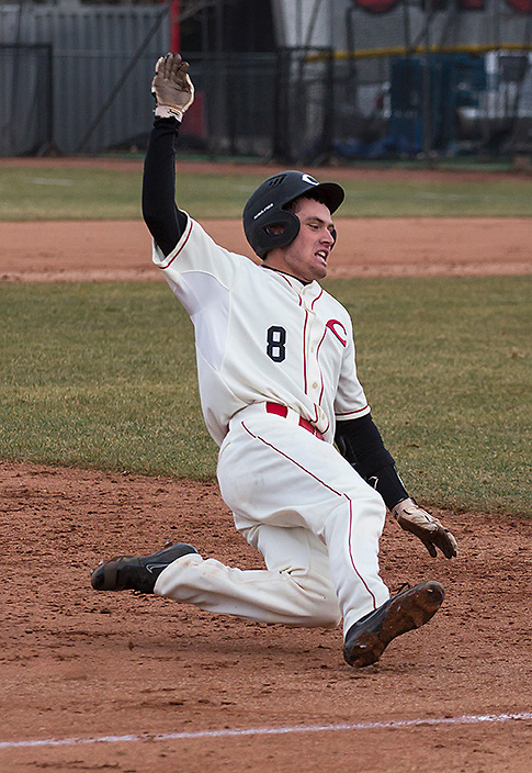 Coconino High's catcher, Todd Furr (Sr.) slides into third base after hitting a triple in the fourth inning at the Flagstaff High vs. Coconino High varsity baseball game on Monday, March 7, 2016. Furr would be awarded an RBI during the play too. (Photo by David Carballido-Jeans)