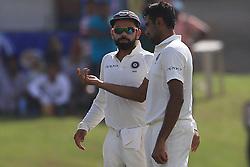 July 27, 2017 - Galle, Sri Lanka - Indian cricket captain Virat Kohli (2R) talks to his team mate Ravichandran Ashwin during the 2nd Day's play in the 1st Test match between Sri Lanka and India at the Galle International cricket stadium, Galle, Sri Lanka on Thursday 27 July 2017. (Credit Image: © Tharaka Basnayaka/NurPhoto via ZUMA Press)