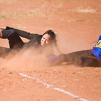032113       Cable Hoover<br /> <br /> Tohatchi Cougar  Michelle Yazzie (8) dives back to third base in an effort to stop Zuni Thunderbird Alissa Paquin (23) Thursday at Zuni High School.
