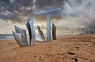 BY THE SEA - OMAHA BEACH - colour photo art by Paul Williams of Omaha beach and the LES BRAVES sculpture to the fallen of D Day. An atmospheric winter scsne taken in 2007