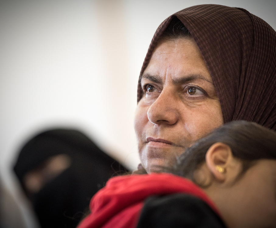 16 February 2020, Irbid, Jordan: A mother holds her daughter in her lap during a caregiver support session led by the Lutheran World Federation at the Islamic Centre in Al-Mazar, offering psychosocial support to Syrian refugee mothers and Jordanian host communities.