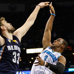 January 19, 2011; New Orleans, LA, USA; New Orleans Hornets point guard Chris Paul (3) shoots over Memphis Grizzlies center Marc Gasol (33) during the fourth quarter at the New Orleans Arena. The Hornets defeated the Grizzlies 130-102 in overtime.  Mandatory Credit: Derick E. Hingle