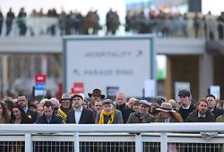 Racegoers in the stands during St Patrick's Thursday of the 2018 Cheltenham Festival at Cheltenham Racecourse.