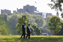 Two police officers patrol outside Windsor Castle during a visit by President Biden on 13th June 2021 in Windsor, United Kingdom. President Biden and First Lady Jill Biden were welcomed at Windsor Castle by the Queen following the G7 summit with a Guard of Honour followed by afternoon tea.