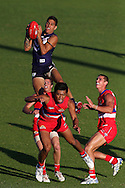 MANDURAH, AUSTRALIA - MARCH 09:  Michael Walters of the Dockers takes a high mark during the round three NAB Cup AFL match between the Fremantle Dockers and the Western Bulldogs at Rushton Park on March 9, 2013 in Mandurah, Australia.  (Photo by Paul Kane/Getty Images) *** Local Caption *** Michael Walters