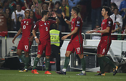October 10, 2017 - Lisbon, Portugal - Portugal's forward Andre Silva (2ndR) celebrates with Portugal's defender Jose Fonte (R), Portugal's midfielder Joao Moutinho (2ndL) and Portugal's midfielder Joao Mario after scoring a goal during the FIFA 2018 World Cup Qualifier match between Portugal and Switzerland at the Luz Stadium on October 10, 2017 in Lisbon, Portugal. (Credit Image: © Carlos Costa/NurPhoto via ZUMA Press)
