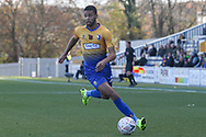 CJ Hamilton of Mansfield Town (22) bursts down the wing during the The FA Cup match between Mansfield Town and Charlton Athletic at the One Call Stadium, Mansfield, England on 11 November 2018.