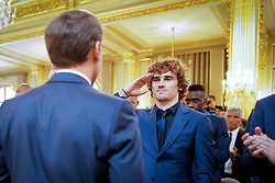French president Emmanuel Macron awards French forward Antoine Griezmann during a Legion of Honour award ceremony for French 2018 football World Cup winners at the Elysee Palace in Paris, on June 4, 2019. Photo by Hamilton/pool/ABACAPRESS.COM