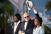 Jesuthasan Antonythasan, director Jacques Audiard and Kalieaswari Srinivasan with the Palme d'or prize for the film Dheepan at the Palm D'Or award winners photo call at the 68th Cannes Film Festival Sunday May 24th 2015, Cannes, France.