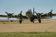 A Boeing B-17G Flying Fortress lands outside the Frontiers of Flight Museum in Dallas on Wednesday, March 20, 2013. (Cooper Neill/The Dallas Morning News)