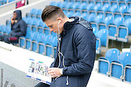 Jack Grealish of Aston Villa chills out and reads the matchday programme as he arrives for the match. EFL Skybet championship match, Queens Park Rangers v Aston Villa at Loftus Road Stadium in London on Sunday 18th December 2016.<br /> pic by Steffan Bowen, Andrew Orchard sports photography.