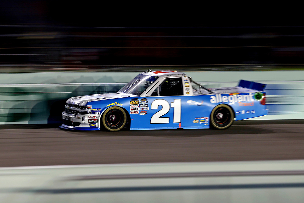 Nov 18, 2016; Homestead, FL, USA; NASCAR Camping World Truck Series driver Johnny Sauter (21) during the Ford Ecoboost 200 at Homestead-Miami Speedway. Mandatory Credit: Peter Casey-USA TODAY Sports