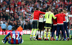 Manchester United celebrate winning The FA Cup Final as Jason Puncheon of Crystal Palace sits on the floor dejected - Mandatory by-line: Robbie Stephenson/JMP - 21/05/2016 - FOOTBALL - Wembley Stadium - London, England - Crystal Palace v Manchester United - The Emirates FA Cup Final