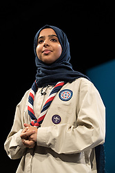 © Licensed to London News Pictures . 03/10/2017 . Manchester , UK . FERDOUS AL-AUDHALI (22 from Solihull) on stage with Chief Scout Bear Grylls , ahead of the Home Secretary , during day three of the Conservative Party Conference at the Manchester Central Convention Centre . Photo credit : Joel Goodman/LNP