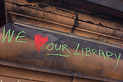 Passionate writing on one of the pillars outside Carnegie Library in Herne Hill, south London while occupiers remain inside the premises on day 6 of its occupation, 5th April 2016. The angry local community in the south London borough have occupied their important resource for learning and social hub for the weekend. After a long campaign by locals, Lambeth have gone ahead and closed the library's doors for the last time because they say, cuts to their budget mean millions must be saved.
