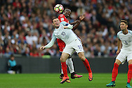 Wayne Rooney, the England captain is challenged by Alfred Effiong of Malta. FIFA World cup qualifying match, european group F, England v Malta at Wembley Stadium in London on Saturday 8th October 2016.<br /> pic by John Patrick Fletcher, Andrew Orchard sports photography.