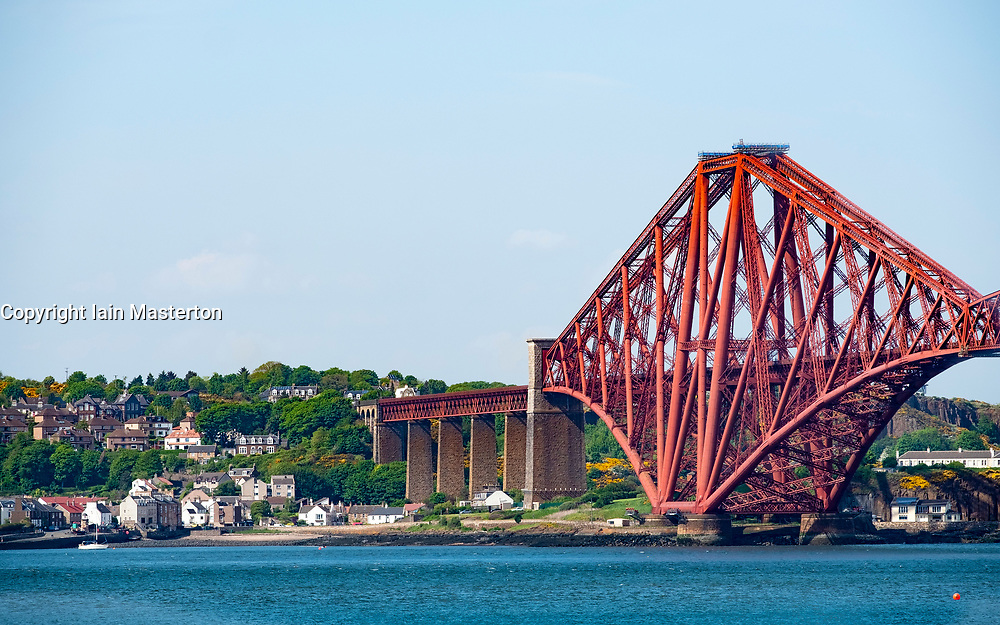 View of the Forth Bridge (Forth Railway Bridge) and North Queensferry in Fife, Scotland, UK