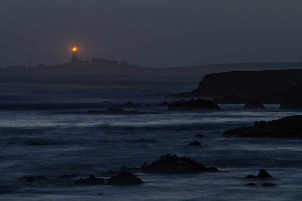 Nightshot of Piedras Blancas Lighthouse near San Simeon on the California Coastline early evening glow.  Licensing and Open Edition Prints.