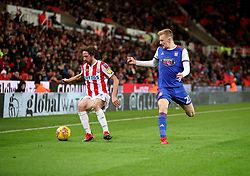 Stoke City's Joe Allen (left) and Ipswich Town's Flynn Downes battle for the ball