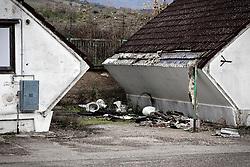 Potenza (PZ), 23-11-2010 ITALY - Il quartiere Bucaletto. Bucaletto è un quartiere popolare della periferia est di Potenza. Fu progettato all'indomani del terremoto dell'Irpinia del 23 novembre 1980, per risolvere i problemi delle famiglie sfollate a causa dei crolli di alcune abitazioni della città, difatti è caratterizzato dalla presenza di abitazioni singole, in prefabbricati..Nella Foto: Il degrado del quartiere con rifiuti speciali e pericolosi.